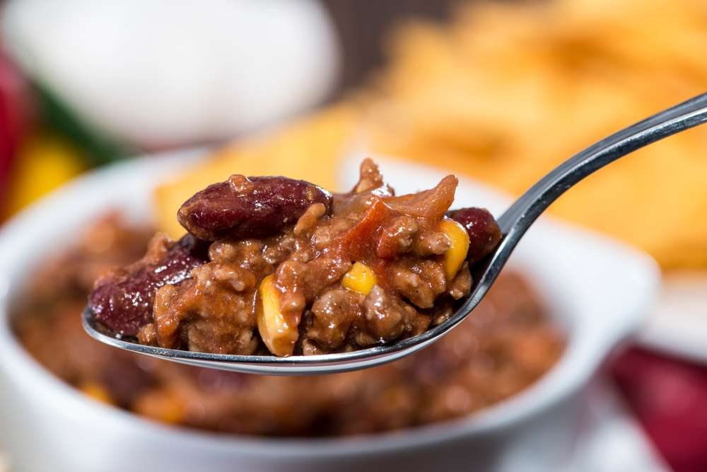 spooned bowl of chili